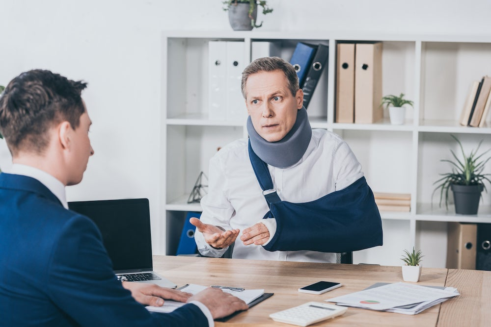 Man in sling with personal injury attorney