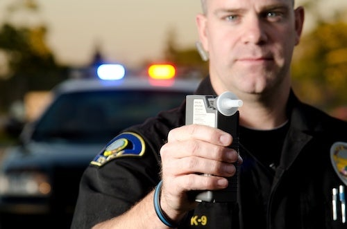 Cop with Breathalyzer