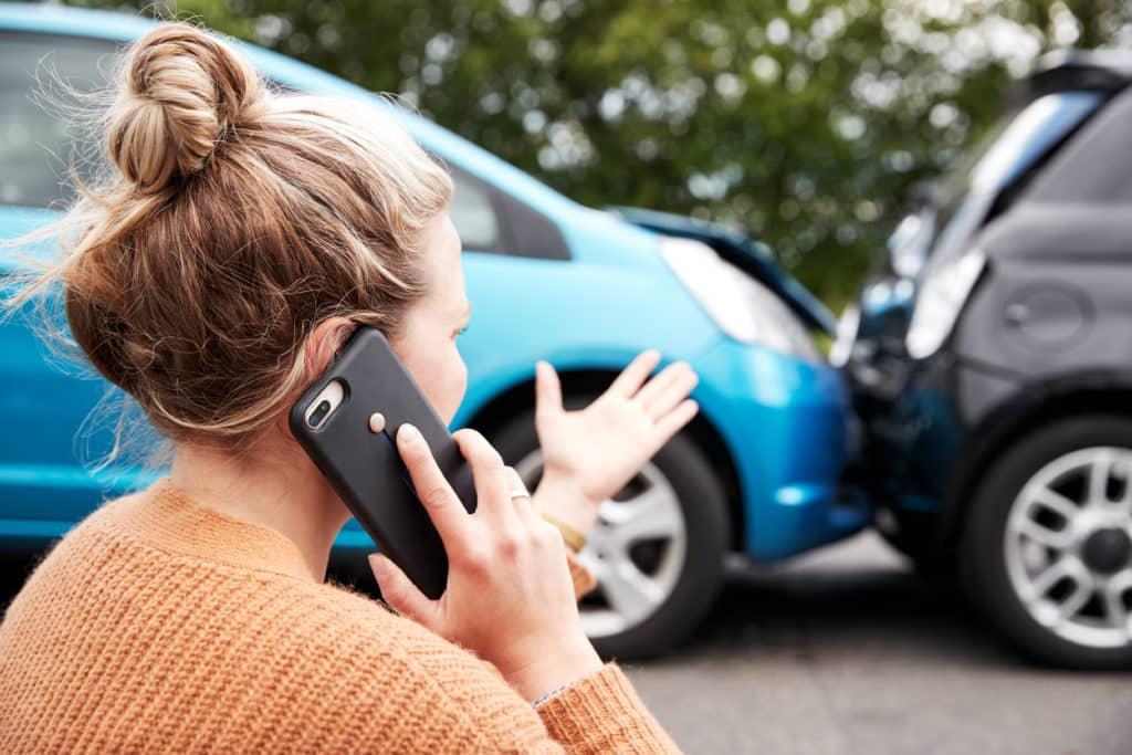 Girl on cellphone at Lyft accident scene