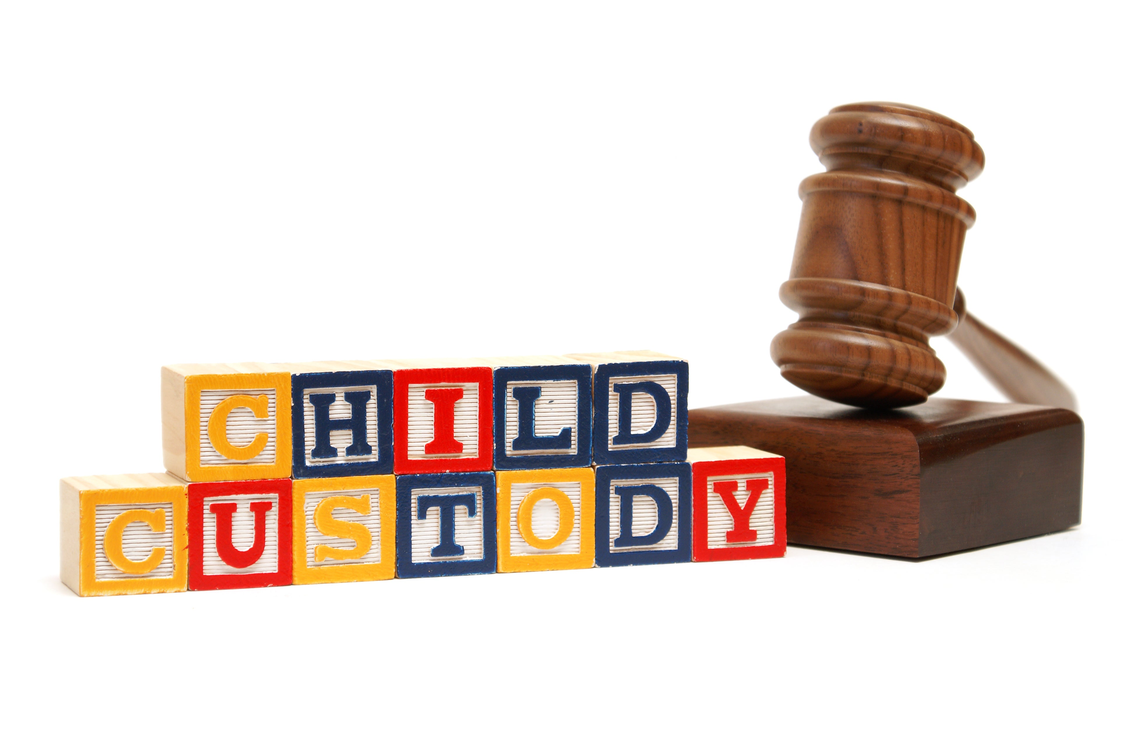 A group of children blocks spells out child custody next to a judges gavel.