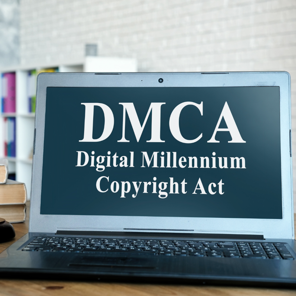 Laptop with NFT crypto art on screen saying DMCA Digital Millenium Copyright Act