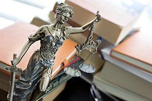 """Who """"Presses Charges"""" in a California Criminal Case?"""