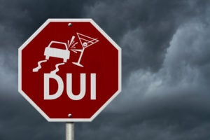 stop sign with DUI illustration