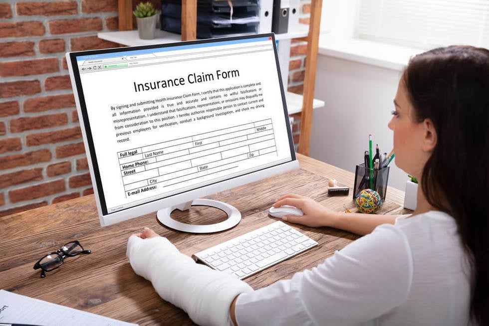 woman deciding between workers compensation and disability benefits