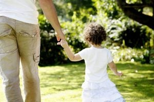 Father Walking hand-in-Hand Protecting His Child
