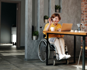 Woman in a wheel chair completes her estate plan virtually with her attorney.