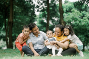 Young family in the park contemplate needing a trust