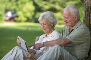 Happy senior couple discuss how to change their Will.