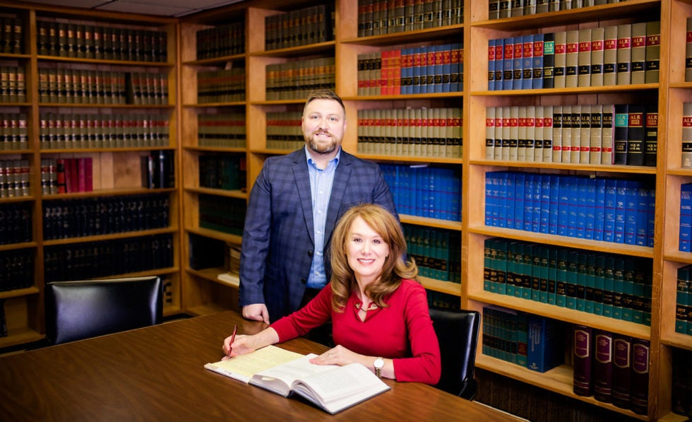Attorneys Ryan Smith and Melanie Lane in Romer and Lane Library