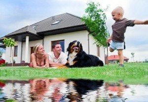 Happy family in front of their house