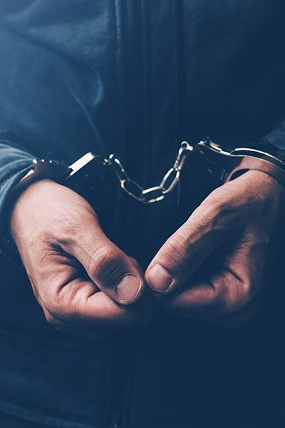 man in handcuffs edmond ok
