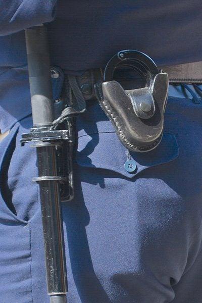 police man with baton on belt edmond ok