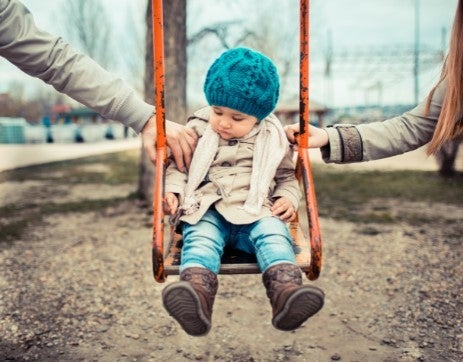 child on swing - child support in Las Cruces NM