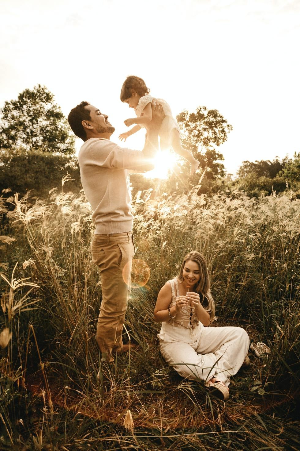 Mother, father, and baby enjoying outdoors