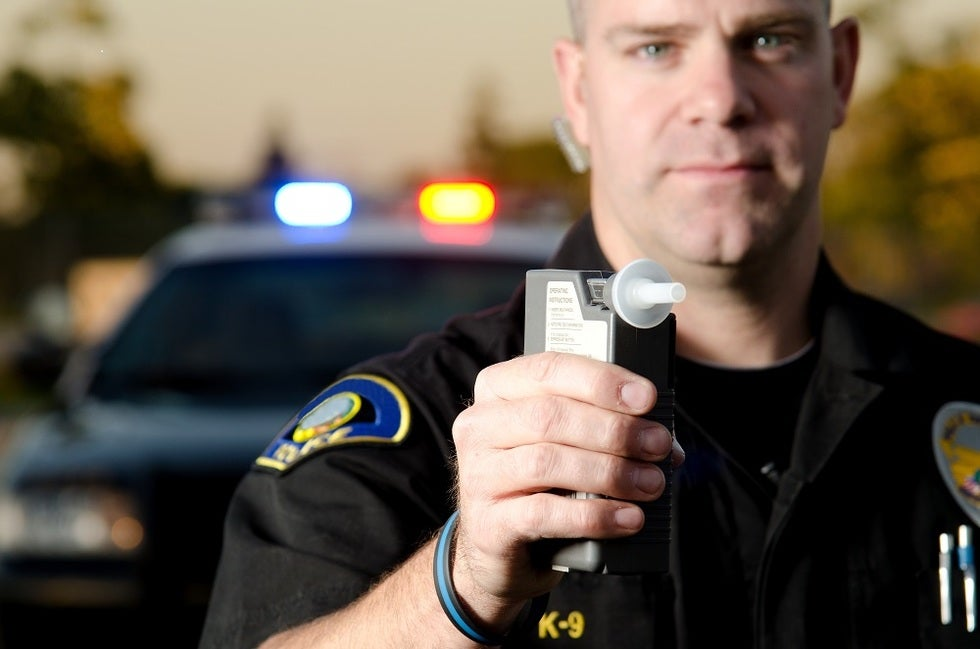 Police officer hold breath test device