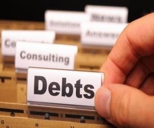 file folder with word debt
