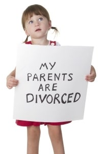 girl holding sign my parents are divorced