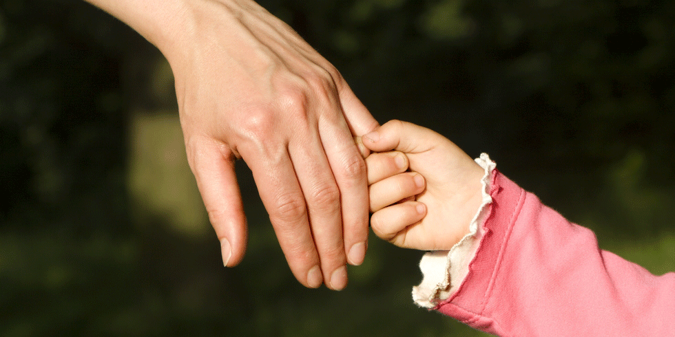 mother holdin hand
