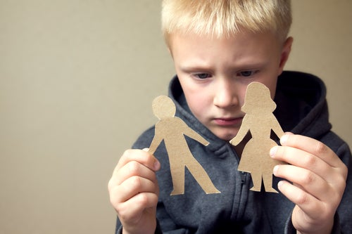 child holding paper family cut outs