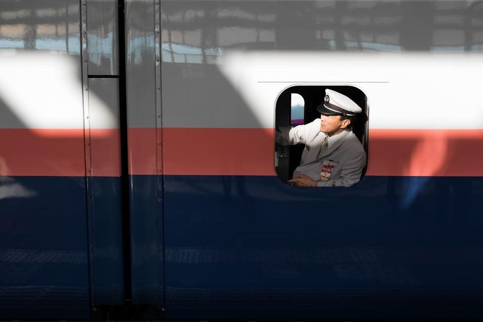 Man in train window