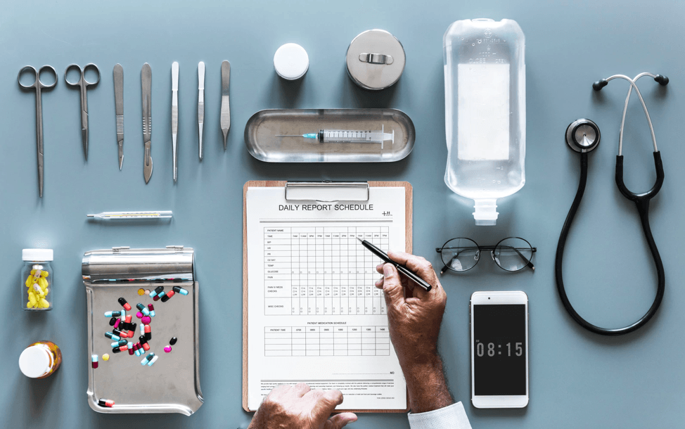 Doctor writing and medical instruments
