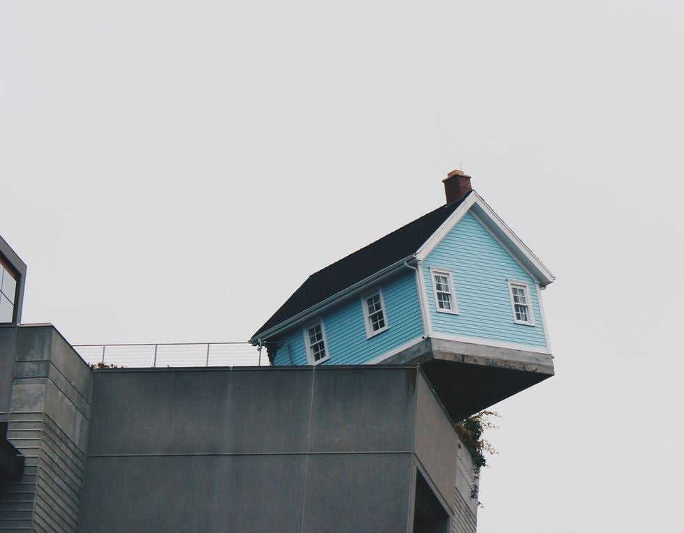 house falling off building