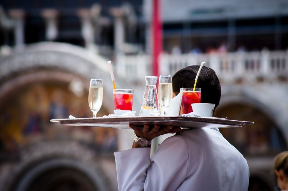 Waiter with drinks- Photo by Kate Townsend on Unsplash