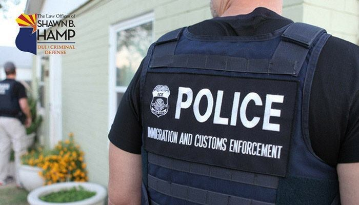 An immigration enforcement officer wearing body armor
