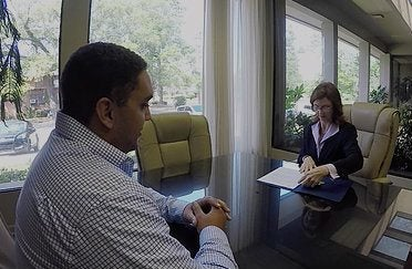 car accident attorney talking to client about repaying medical bills from accident