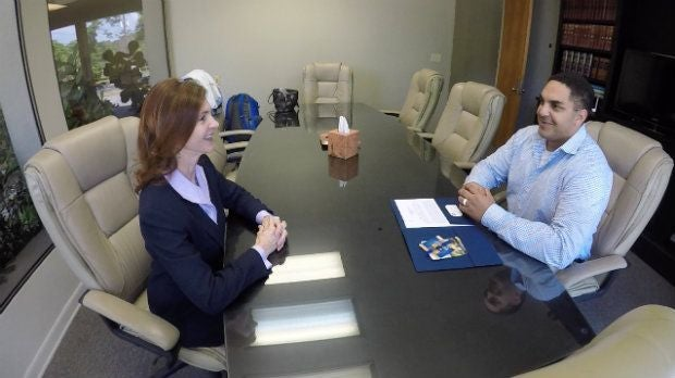 personal injury attorney meeting with client to discuss car accident insurance claim