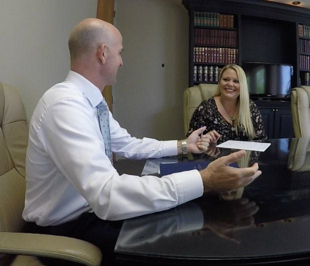 personal injury attorney talking to client during intake