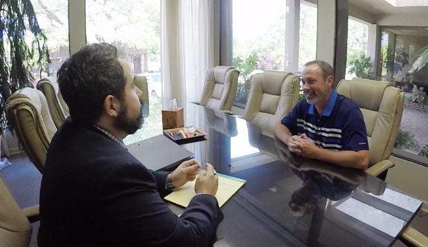 car accident lawyer talking to client about insurance coverage