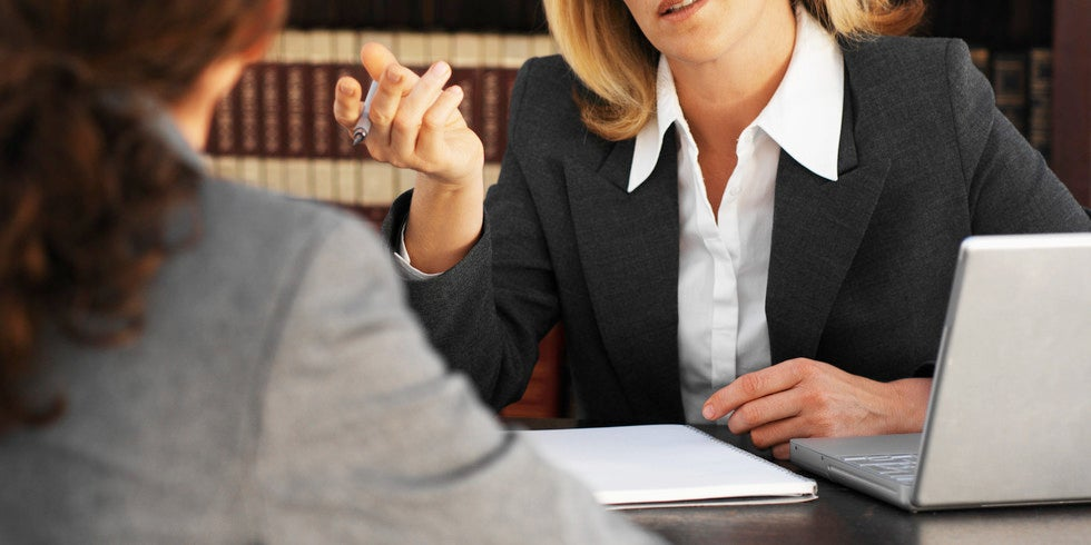 Woman meeting with a lawyer in an office.